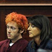Der mutmaßliche Amokschütze von Aurora wirkte teilnahmslos und benommen bei seinem ersten Auftritt vor Gericht.