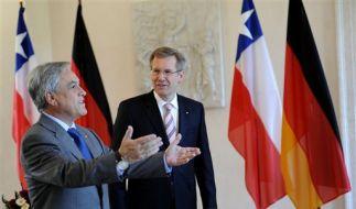 Der chilenische Präsident Pinera (li.) bei Bundespräsident Wulff. (Foto)