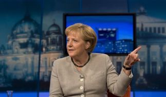 Die Krise wegregieren: Kanzlerin Angela Merkel. (Foto)