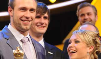 Diskuswerfer Robert Harting (l) und Biathletin Magdalena Neuner sind die «Sportler des Jahres» 2012. (Foto)