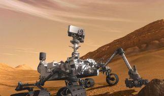 Eine künstlerische Darstellung zeigt die Landung des Marsrover «Curiosity» auf dem Mars. (Foto)
