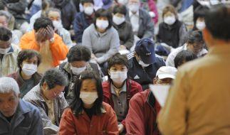 Einwohner der Stadt Itate, 40 Kilometer von der Atomruine entfernt, bei einer Veranstaltung der Regi (Foto)