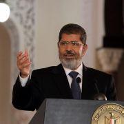 Er geht auf die Opposition zu, hält aber auch halber Wegstrecke an: Ägyptens Präsident Mursi.