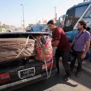 Flucht aus Syrien: Iraker, die vor der Gewalt aus ihrem eigenen Land geflohen sind, machen sich wieder auf die Suche nach einem sicheren Ort.