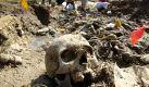 Forensiker exhumieren Leichen aus einem Massengrab im Dorf Kamenica in Bosnien. Foto: Fehim/Demir Foto: Fehim/Demirdpa