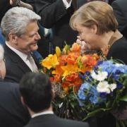 Glückwünsche von der Kanzlerin: Am Freitag soll Joachim Gauck als Bundespräsident vereidigt werden.
