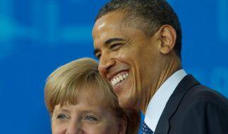 Haben gut lachen: das «Forbes»-Spitzenduo Angela Merkel und Barack Obama. (Foto)