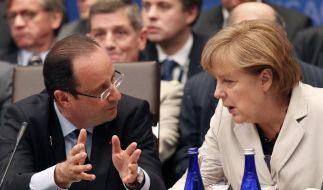 Hollande und Merkel streiten über Eurobonds (Foto)