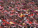 Jahrestag des Aufstands in Syrien: Trauer und bestellter Jubel (Foto)