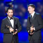Oscarprämiert für ihre Musik zu The Social Network: Trent Reznor (links) und Atticus Ross.