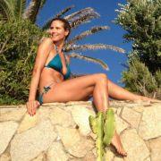 Keine Woche ohne sexy Foto: Hier twittert sich Heidi Klum auf Sardinien.