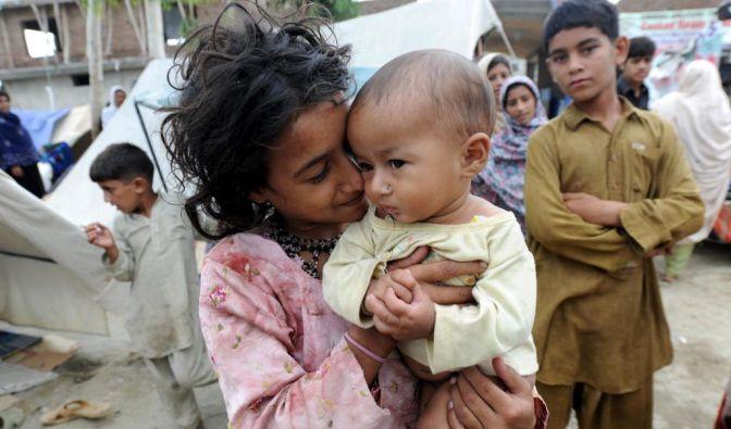 Kinder leiden unter Naturkatastrophen (Foto)
