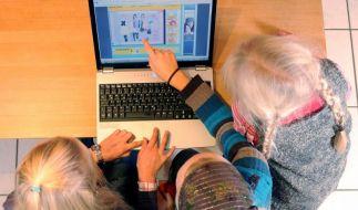 Kinder lernen online (Foto)