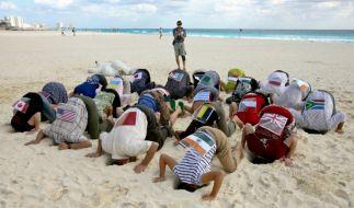 Klimaschützer demonstrieren in Cancún (Foto)