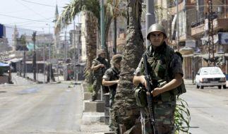 Libanesische Soldaten patroullieren in der «Syria Street». Sicherheit können sie nicht garantieren. (Foto)
