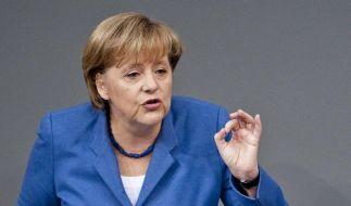Merkel: Investoren bei Euro-Rettung einbeziehen (Foto)