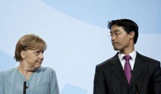 Merkel kontra Rösler (Foto)