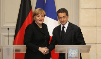 Merkel und Sarkozy wollen mit einem Masterplan den Euro retten, doch andere Länder sind skeptisch.  (Foto)