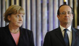 Merkel und Hollande bekennen sich demonstrativ zum Euro (Foto)