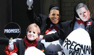 Merkel und Obama Masken (Foto)