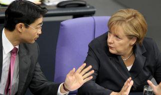 Merkel und Rösler beschwören Zusammenhalt (Foto)