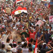 Mursis Anhänger feiern die Wahl des Führers der Muslim-Bruderschaft auf dem Kairoer Tahrir-Platz.