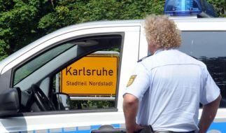 Nach einer Schießerei in Karlsruhe riegelten Spezialkräfte der Polizei den Tatort ab. (Foto)