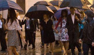 Obama in Kuba: Regen und verhaltene Blicke prägten die Szenerie in der abgeriegelten Altstadt Havannas. (Foto)