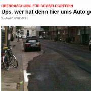 Parkendes Auto? Egal, dachte sich eine Baufirma in Düsseldorf - und teerte ringsrum.