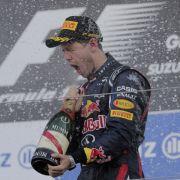 Prost! Sebastian Vettel ist in der zweiten Saisonhälfte in Fahr- und Feierlaune gekommen.