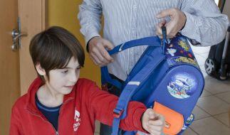 Rückenschmerzen bei Grundschülern vorbeugen (Foto)