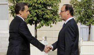 Sarkozy übergibt an Hollande (Foto)