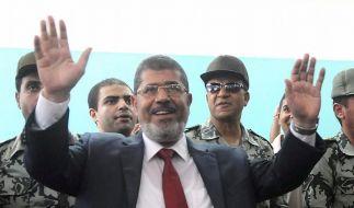 Schafft Mohammed Mursi es, Ägypten zwischen Islamisten und Militär zur Demokratie zu führen? (Foto)