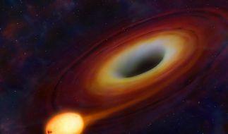 Schwarzes Loch reißt Stern in Stücke (Foto)