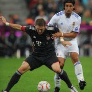 Im DFB-Team ein kongeniales Duo, in der Champions League direkte Rivalen: Bastian Schweinsteiger und Sami Khedira.
