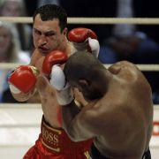 Schwer gezeichnet: 2008 musste sich Wladimir Klitschko heftig gegen Tony Thompson wehren.