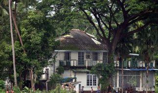 Sicherheitskräfte haben das Haus der unter Hausarrest stehenden Bürgerrechtlerin abgeriegelt. (Foto)
