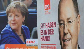 Sie buhlen bis zuletzt um Stimmen: Amtsinhaberin Angela Merkel und ihr Herausforderer Peer Steinbrück. (Foto)