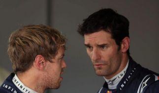 Sind sich derzeit gar nicht grün: die Red-Bull-Fahrer Sebastian Vettel (links) und Mark Webber. (Foto)