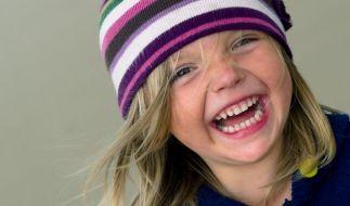 Studie: Lachen scheint vor Schmerzen zu schützen (Foto)