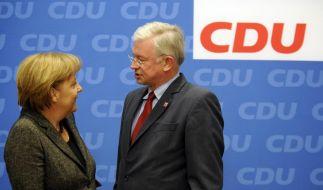 Uneins: Angela Merkel und Roland Koch (Foto)