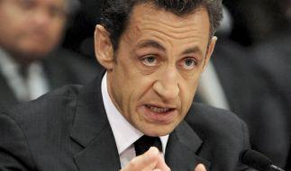 Versammelt neue Regierungsmitglieder um sich: Frankreichs Präsident Nicolas Sarkozy. (Foto)