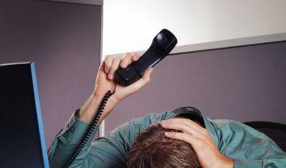 Verzweifeln im Büro (Foto)