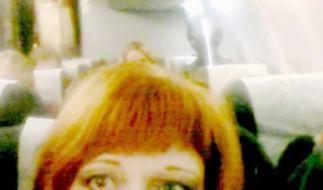 Was sitzt hinter der rothaarigen Frau? Alien, Geist - oder beides? (Foto)