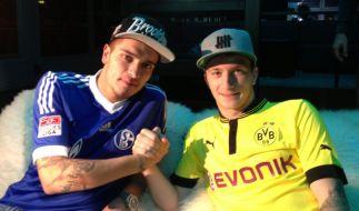 Wenn Kumpels Gegner werden: Schalkes Roman Neustädter gegen BVB-Star Marco Reus. (Foto)