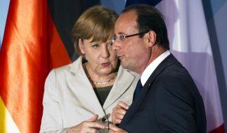 Wollen in Sachen Euro-Rettung eng zusammenarbeiten: Angela Merkel und François Hollande. (Foto)