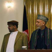 Zweifelhafte Freunde: Afghanistans Präsident Karzai mit den Vizepräsidenten Fahim und Khalili.