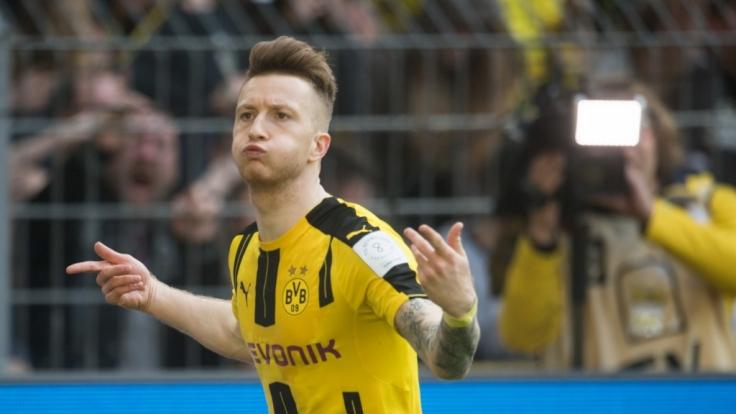 Marco Reus und seine Mannschaft Borussia Dortmund treffen an diesem Samstag auf den FC Augsburg.