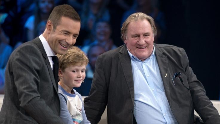 Kai Pflaume mit Julius und Gérard Depardieu. (Foto)