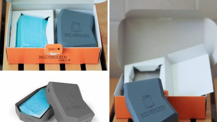 Der Duschbrocken ist in einem Pappkarton verpackt. (Foto)